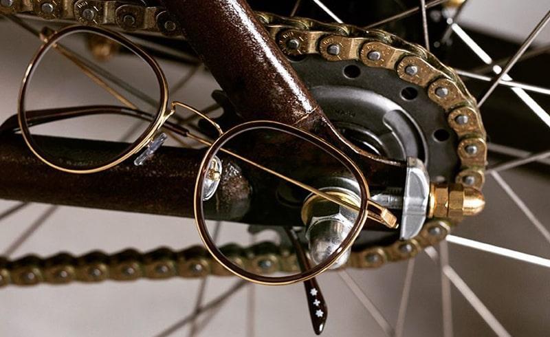 Очки в бронзовой металлической оправе фото